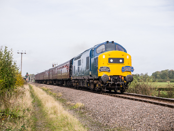 37215 accelerates away from Toddington with the 1345 service to Cheltenham Racecourse on Saturday 18th October during the 50th Birthday Golden Jubilee celebrations.